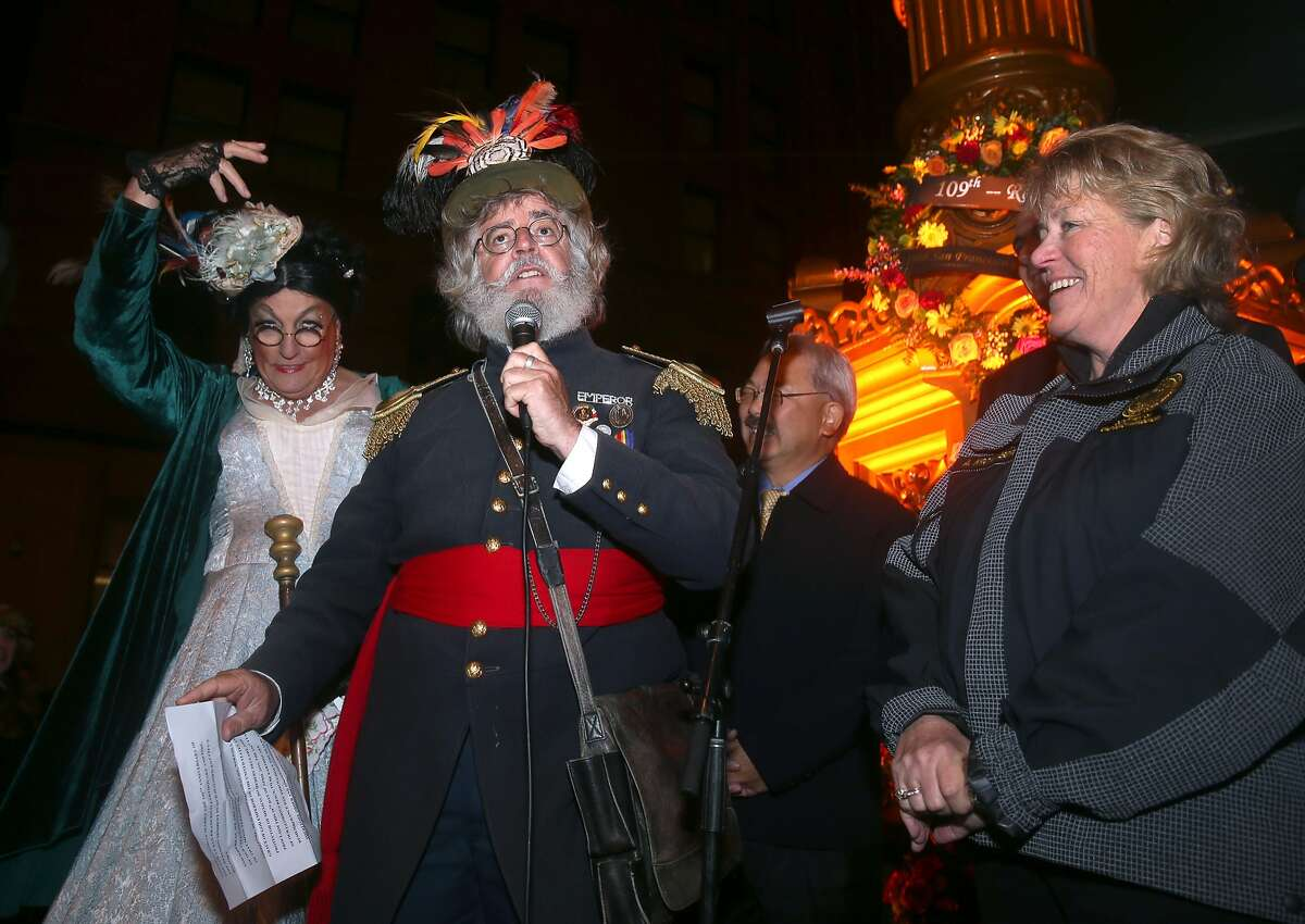 Dressed as Emperor Norton, Joseph Amster speaks to a crowd gathered at Lotta's Fountain to commemorate the 109th anniversary of the 1906 earthquake in San Francisco, Calif. on Saturday, April 18, 2015. At right is Anne Kronenberg, executive director of the city's Department of Emergency Management.