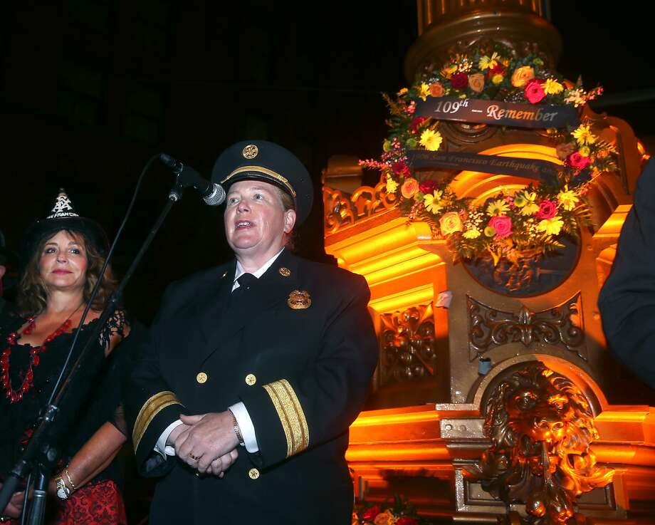 Fire Chief Joanne Hayes-White speaks to a crowd gathered at Lotta's Fountain to commemorate the 109th anniversary of the 1906 earthquake in San Francisco, Calif. on Saturday, April 18, 2015. At left is Donna Ewald Huggins, dressed as Lillie Coit. Photo: Paul Chinn, The Chronicle