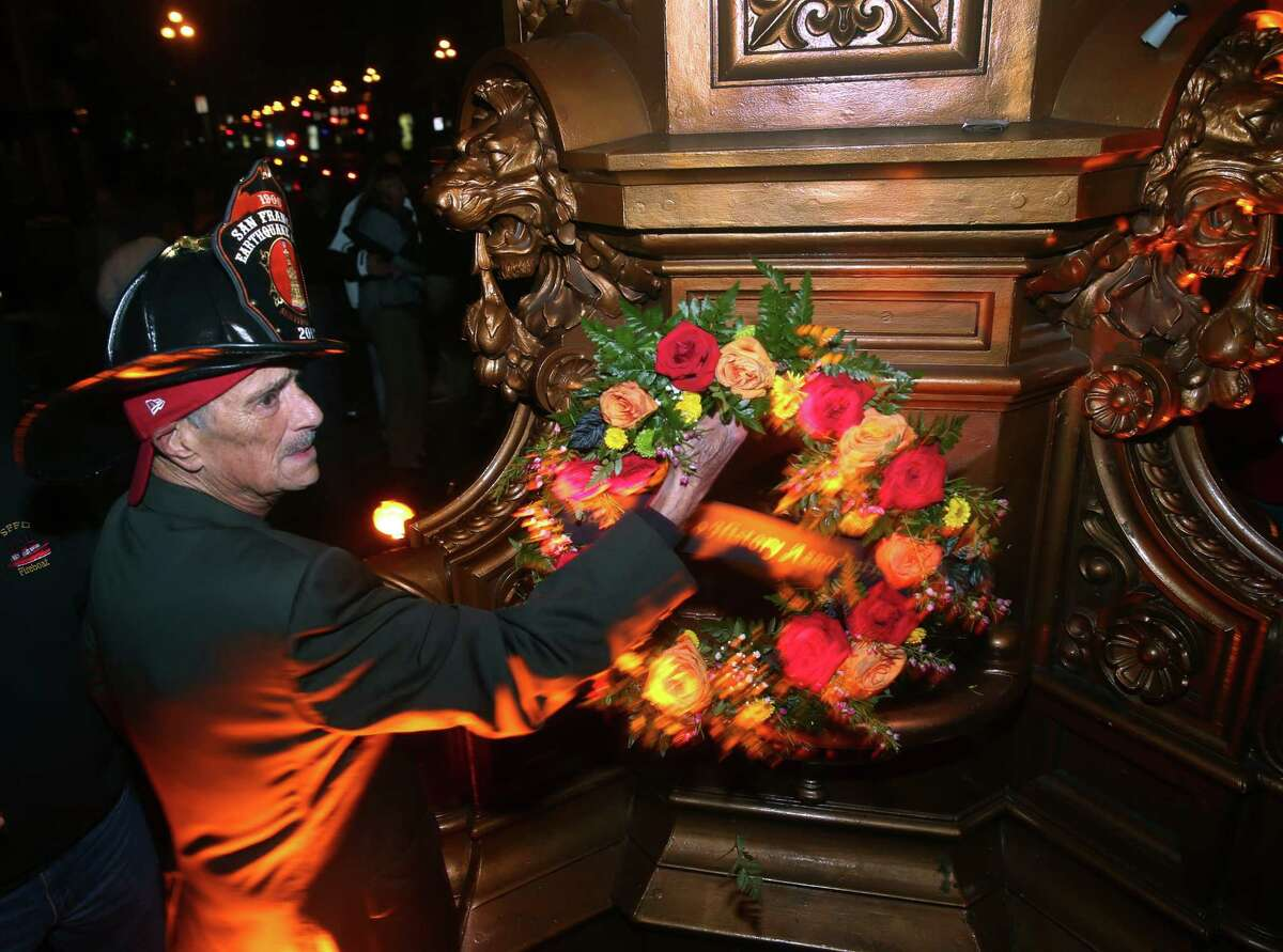 Ron Ross, president of the San Francisco History Association, adjusts a wreath placed on Lotta's Fountain to commemorate the 109th anniversary of the 1906 earthquake in San Francisco, Calif. on Saturday, April 18, 2015.