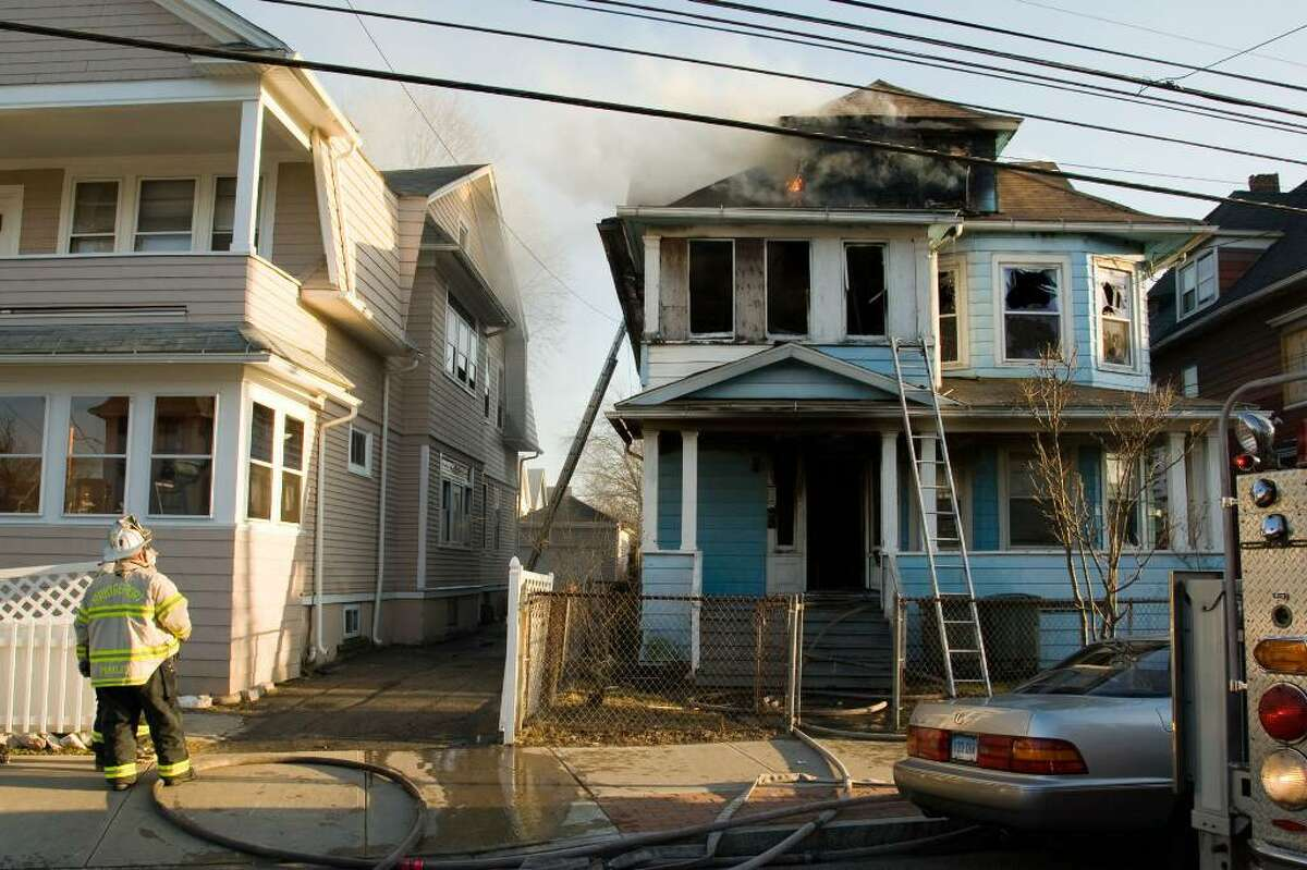 A two-alarm fire in a Connecticut Avenue three-family house displaced 11 people Monday afternoon.