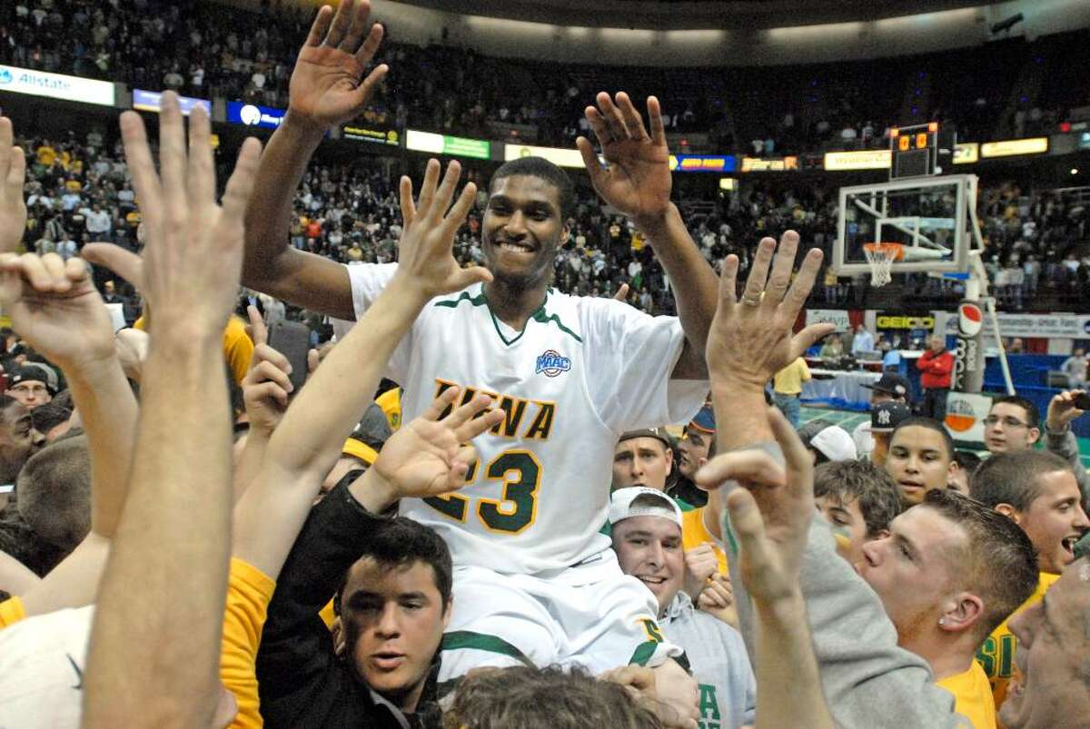 Fans hoist Siena's Edwin Ubiles on their shoulders after Siena beat Fairfield 72-65 in the championship game of the NCAA Metro Atlantic Athletic Conference men's college basketball tournament in Albany, N.Y., on Monday, March 8, 2010. (AP Photo/Tim Roske)