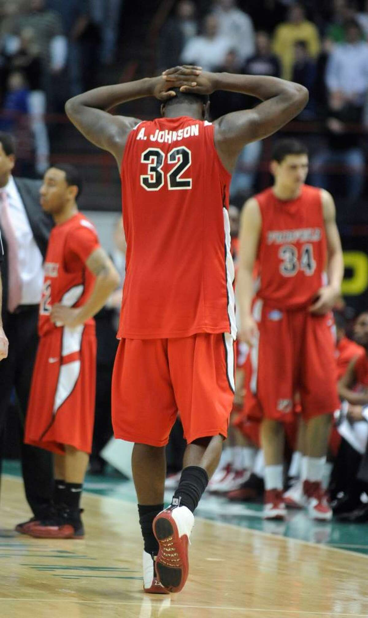 Fairfield's Anthony Johnson reacts in the closing moments of a loss to Siena in the championship game of the NCAA Metro Atlantic Athletic Conference men's college basketball tournament in Albany, N.Y., on Monday, March 8, 2010. (AP Photo/Tim Roske)