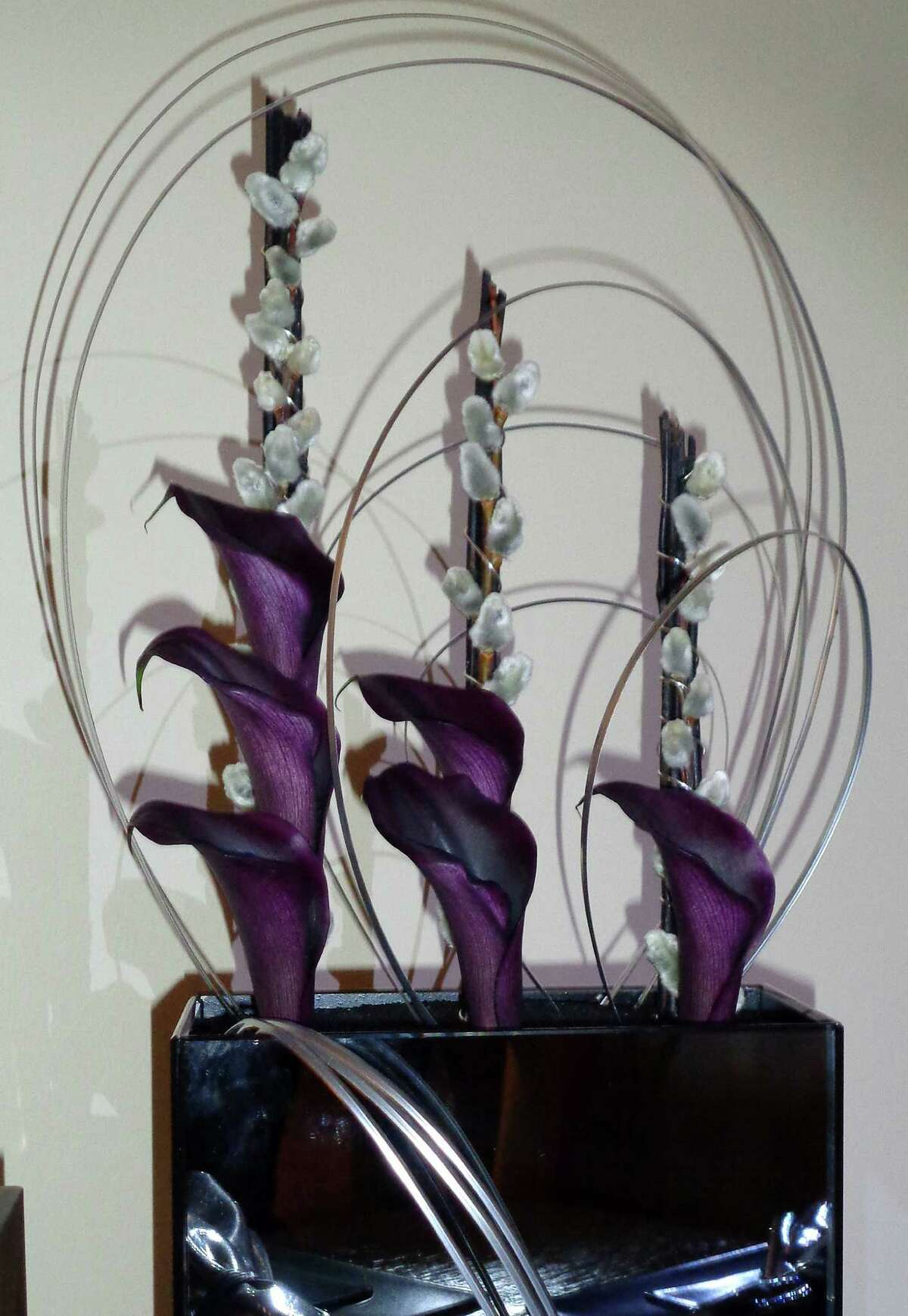 Entries in the Fairfield Garden Club's Centennial Flower Show ranged from traditional designs to more contemporary, as with this one, which reflects the 100-year history of the organization, which was started in 1915 with Mabel Osgood Wright as the first president.