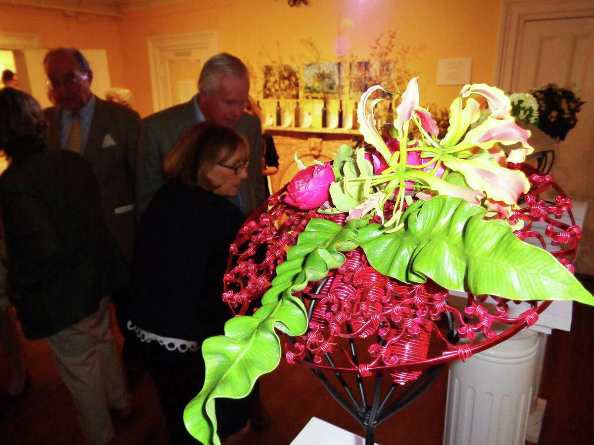 Floral designs created to resemble hats were a hit with the hundreds of patrons and flower club members who attended a preview party for the Fairfield Garden Club's Centennial Flower Show at the Burr Homestead on Friday.