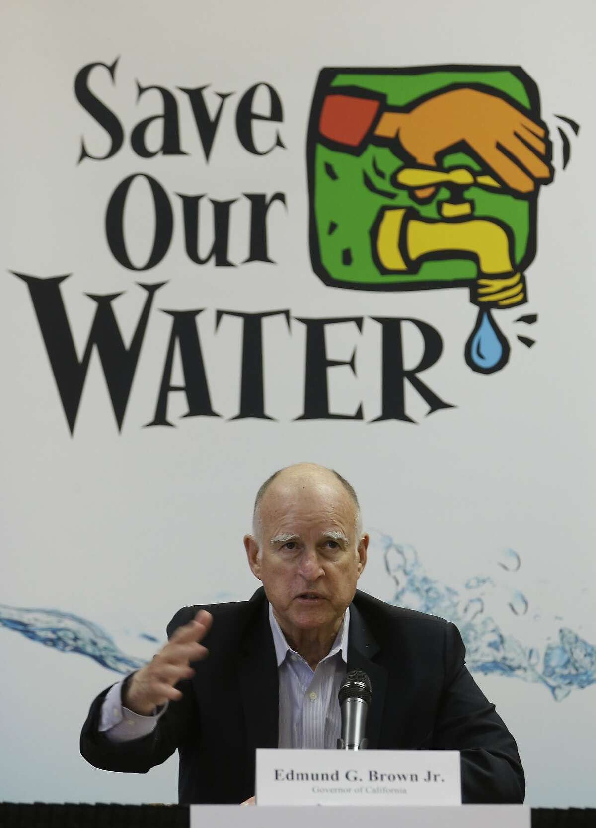 Gov. Jerry Brown talks to reporters at the after a meeting with businesses affected by the drought at his Capitol office in Sacramento, Calif., Thursday, April 16, 2015. Cities expected to slash water use in the drought are revolting against Brown's mandatory water restrictions, and dozens of agencies are telling water regulators that their assigned water use targets are unrealistic and unfair. (AP Photo/Rich Pedroncelli)