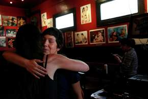 Jamon Franklin, right, hugs Lauren Tabak goodbye after finishing an afternoon of interviews and filming for the Lexington Club Archival Project at the Lexington Club March 20, 2015 in San Francisco, Calif.