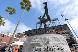 SAN FRANCISCO, CA - APRIL 13:  Fans entering the ball park walk a statue former San Francisco Giants pitcher and MLB Hall of Famer Juan Marichal prior to the start of the game between the Colorado Rockies and San Francisco Giants on Opening Day at AT&T Park on April 13, 2015 in San Francisco, California.  (Photo by Thearon W. Henderson/Getty Images)