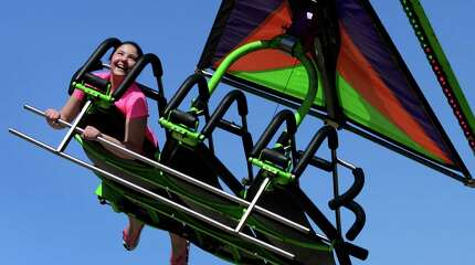 Carla Leonzi, 11, of Shelton, enjoys a ride on the Cliff Hanger, during the Trumbull Rotary Carnival at Hillcrest Middle School in Trumbull, Conn., on Saturday Apr. 18, 2015. The Trumbull Rotary Carnival raises money for local and international charity projects. All the club proceeds come from ticket sales and our food booth. The carnival continues on Sunday.