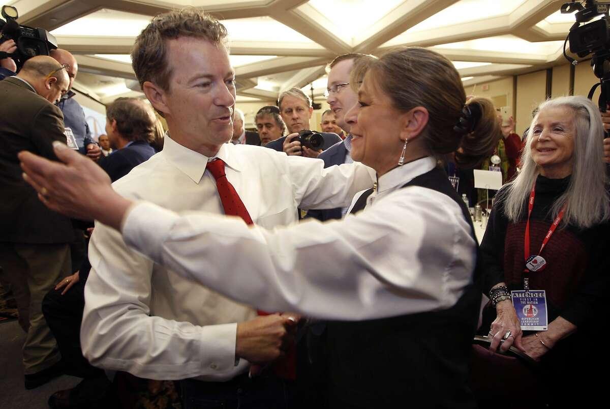 Republican presidential hopeful Sen. Rand Paul, R-Ky., gets a hug after speaking at the Republican Leadership Summit Saturday, April 18, 2015, in Nashua, N.H. (AP Photo/Jim Cole)