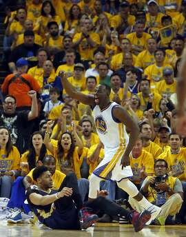 Golden State Warriors' Draymond Green celebrates a basket  against New Orleans Pelicans' Anthony Davis in 2nd quarter during Game 1 of the 1st Round of NBA Western Conference Playoffs at Oracle Arena in Oakland, Calif., on Saturday, April 18, 2015.