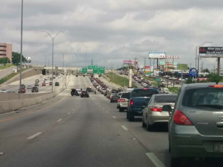 Eastbound lanes of Loop 410 have been closed while police and firefighters investigate a vehicle fire on the highway. Photo: By Jacob Beltran, For MySA.com