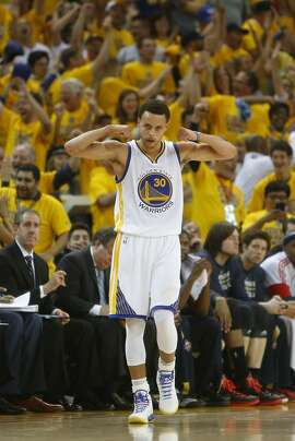 Golden State Warriors' Stephen Curry celebrates a basket while being fouled in 2nd quarter against New Orleans Pelicans during Game 1 of the 1st Round of NBA Western Conference Playoffs at Oracle Arena in Oakland, Calif., on Saturday, April 18, 2015.