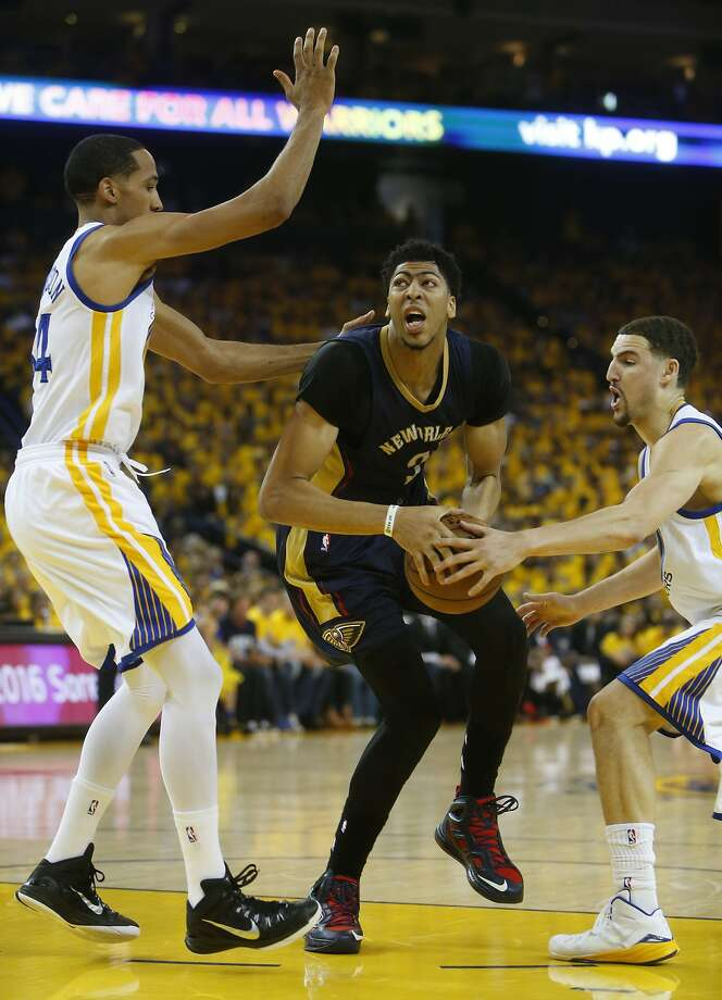 Golden State Warriors' Klay Thompson and Shaun Livingstone defend against New Orleans Pelicans' Anthony Davis during Game 1 of the 1st Round of NBA Western Conference Playoffs at Oracle Arena in Oakland, Calif., on Saturday, April 18, 2015. Photo: Scott Strazzante, The Chronicle