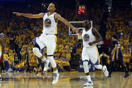 Stephen Curry does his happy dance as he and Draymond Green head upcourt after Curry's basket in the first quarter. The Warriors opened their playoffs by seizing a 28-13 lead.