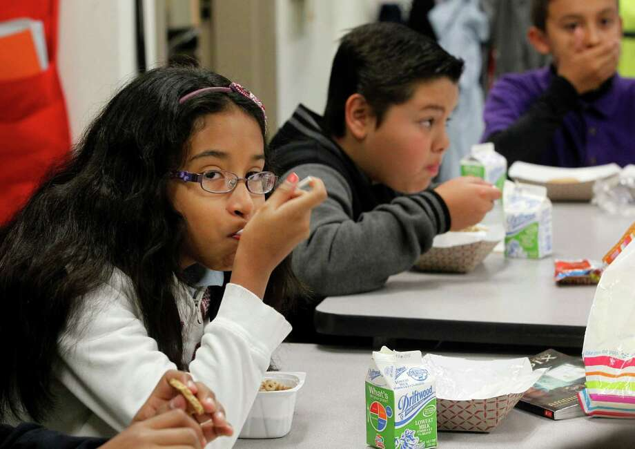 Students at Stanley Mosk Elementary School in Los Angeles eat breakfast in their classroom.. Photo: Nick Ut / Associated Press / AP