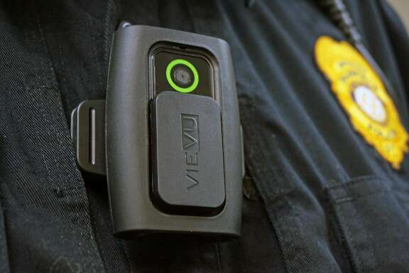Connecticut lawmakers want to study the use of body cameras by local police to record incidents as they happen. Above, the Fairfield Police Department is testing out different body cameras for possible use by its officers, including this one.