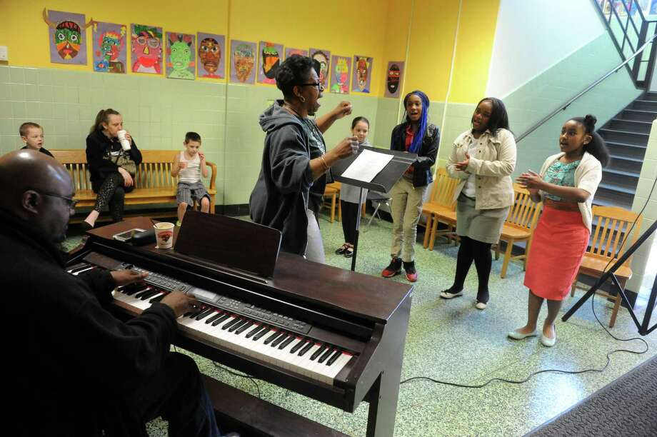 Linda Mitchell leads the Giffen Outreach Community Chorus as part of Authors & Illustrators Day at Giffen Memorial Elementary School on Saturday April 18, 2015 in Albany, N.Y. (Michael P. Farrell/Times Union) Photo: Michael P. Farrell / 00031491A