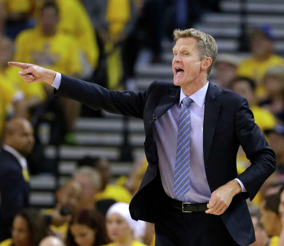 Golden State Warriors head coach Steve Kerr directs his team against the New Orleans Pelicans during the first half in Game 1 of the NBA basketball playoffs Saturday, April 18, 2015, in Oakland, Calif. (AP Photo/Marcio Jose Sanchez) Photo: Marcio Jose Sanchez / Associated Press / AP