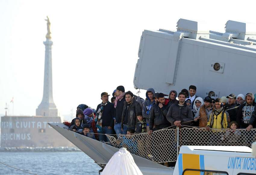 A boat transporting migrants arrives in the port of Messina after a rescue operation at see on April 18, 2015 in Sicily. A surge of migrants pouring into Europe from across the Mediterranean won't end before chaos in Libya is controlled, Italy's prime minister said yesterday, as the Vatican condemned a deadly clash between Muslim and Christian refugees on one boat. Italian authorities have rescued more than 11,000 migrants making the often deadly voyage from North Africa in the past six days, with hundreds more expected, the coastguard said. AFP PHOTO / GIOVANNI ISOLINOGIOVANNI ISOLINO/AFP/Getty Images