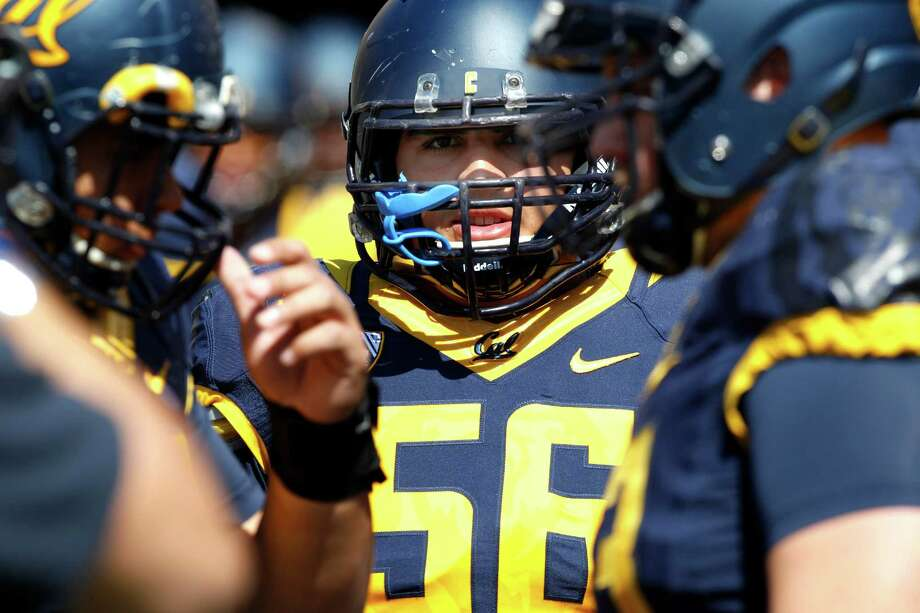 Cal offensive lineman Michael Trani (56) and his team come out for Saturday's spring scrimmage at Memorial Stadium in Berkeley. Photo: Santiago Mejia / The Chronicle / ONLINE_YES