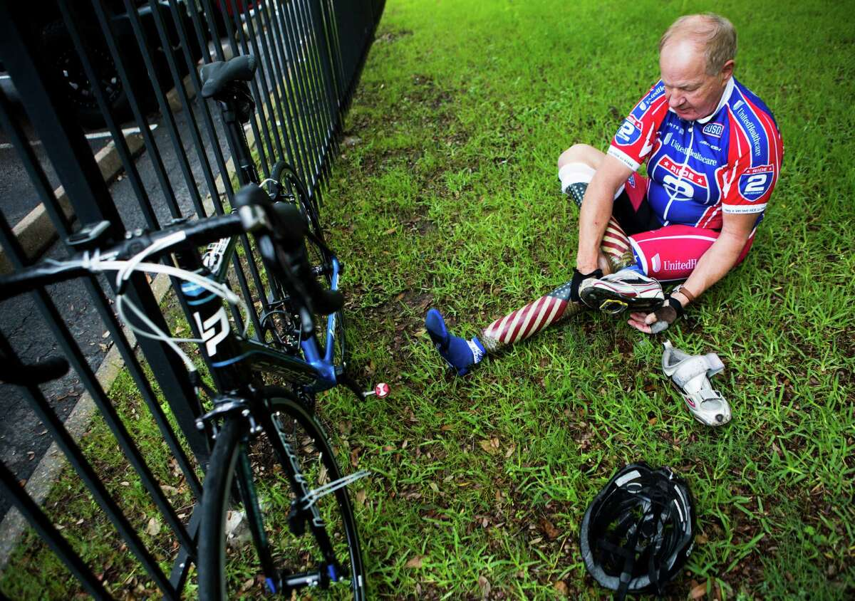 Duane Wagner, a veteran and Ride 2 Recovery athlete puts on his cycling shoes. Wagner, 68, was injured in Vietnam when a grenade blew off his legs; now, he says cycling to help others gives him a