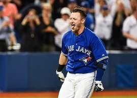 Toronto Blue Jays' Josh Donaldson trots home after hitting the game-winning home run in the 10th inning of a baseball game against the Atlanta Braves in Toronto, Saturday, April 18, 2015. The Blue Jays from 6-5 in 10 innings. (Aaron Vincent Elkaim/The Canadian Press via AP)   MANDATORY CREDIT