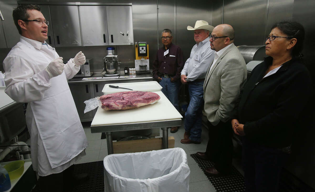 Sales Manager Josh Klein (left) speaks Monday April 13, 2015 at Labatt Food Service's Direct Source Meats about cutting beef shoulder meat. Attending the tour of Direct Source Meats are (center to left) Elwood Pahi of the Navajo Nation, Dan Byrd of Byrd Cattle Company, Tim Kozenskie of Navajo Gaming, and Nora Pahi also of the Navajo Nation. Labatt Food Services is leading an effort to make Navajo and other Native Americans niche players in the beef industry and industries other than gambling.