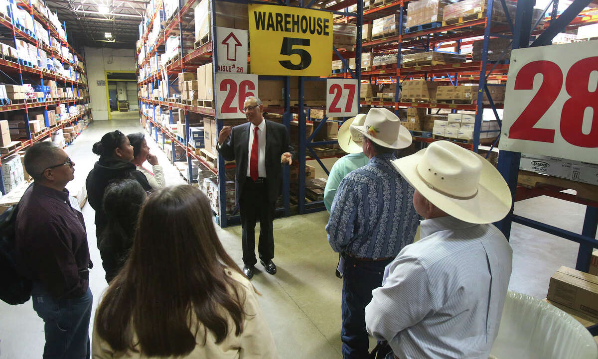 Al Silva, chief operating officer for Labatt, leads a tour of the company's warehouse. The group included those interested in Labatt's efforts to make Native Americans niche players in the beef industry.