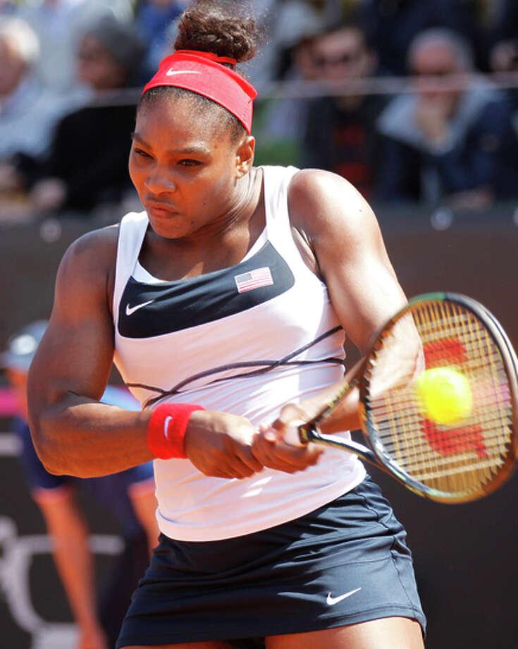 Serena Williams returns to Italy's Camila Giorgi. Photo: Felice Calabro' / Associated Press / AP