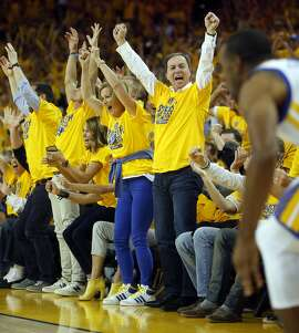 Golden State Warriors' co-owner Joe Lacob cheers after Andre Iguodala's 3-pointer in 3rd quarter of Warriors' 106-99 win over the New Orleans Pelicans in Game 1 of the 1st Round of NBA Western Conference Playoffs at Oracle Arena in Oakland, Calif., on Saturday, April 18, 2015.