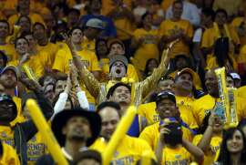 Golden State Warriors' fan Oliver Wald of San Francisco cheers during Warriors' 106-99 win over New Orleans Pelicans in Game 1 of the 1st Round of NBA Western Conference Playoffs at Oracle Arena in Oakland, Calif., on Saturday, April 18, 2015.