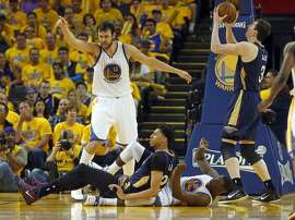 Golden State Warriors' Andrew Bogut points after Draymond Green drew an offensive foul on New Orleans Pelicans' Anthony Davis during Warriors' 106-99 win in Game 1 of the 1st Round of NBA Western Conference Playoffs at Oracle Arena in Oakland, Calif., on Saturday, April 18, 2015.