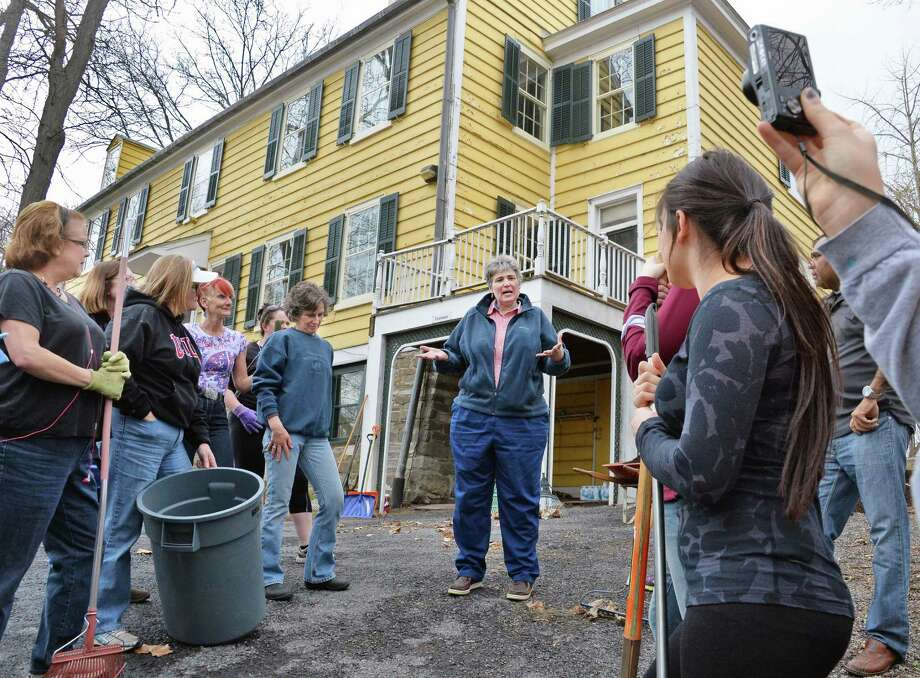 Historic Cherry Hill director Liselle LaFrance, center, instructs Albany County Convention & Visitors Bureau (ACCVB) staff and other representatives from hospitality/tourism partners throughout Albany County during a Hospitality Gives Back: Clean-Up Day at Historic Cherry Hill Friday April 17, 2015 in Albany, NY.  (John Carl D'Annibale / Times Union) Photo: John Carl D'Annibale / 00031488A