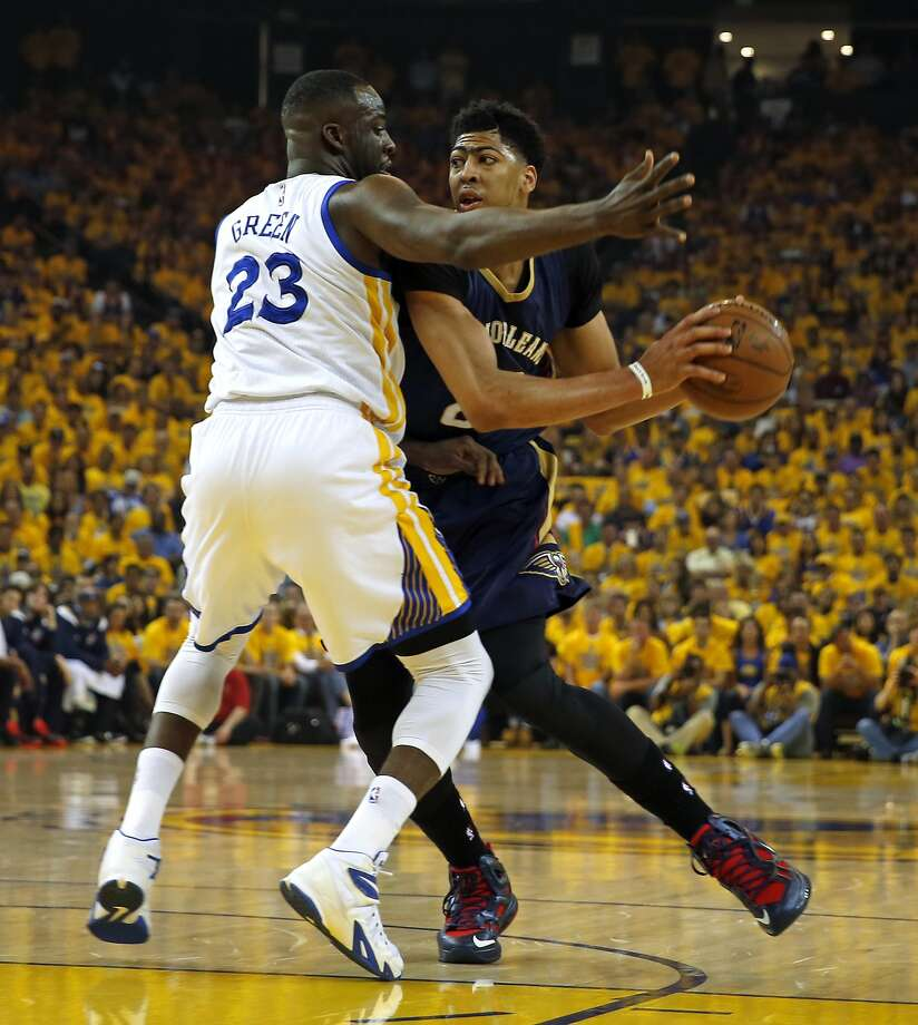 Golden State Warriors' Draymond Green defends against New Orleans Pelicans' Anthony Davis in 1st quarter during Warriors' 106-99 win during Game 1 of the 1st Round of NBA Western Conference Playoffs at Oracle Arena in Oakland, Calif., on Saturday, April 18, 2015. Photo: Scott Strazzante, The Chronicle