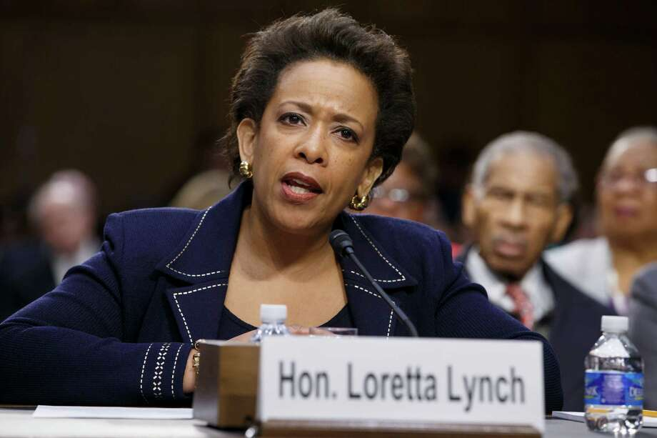 """FILE - In this Jan. 28, 2015 file photo, Attorney General nominee Loretta Lynch testifies on Capitol Hill in Washington. President Barack Obama on Friday said it was """"crazy"""" and """"embarrassing"""" the way the Republican-led Senate has held up confirmation of his attorney general nominee, Loretta Lynch. """"What are we doing here?"""" Obama said. """"I have to say there are times when the dysfunction in the Senate just goes too far. This is an example of it. It's gone too far. Enough. Enough. """"Call Loretta Lynch for a vote,"""" he said emphatically. """"Get her confirmed.""""  (AP Photo/J. Scott Applewhite, File) ORG XMIT: WX108 Photo: J. Scott Applewhite / AP"""