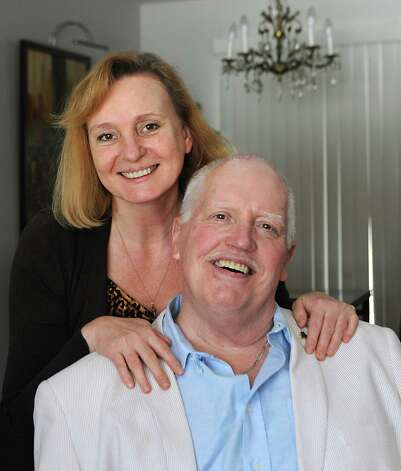Tom Bradley sits with his wife, Olga at their home on Thursday, March 12, 2015 in Guilderland, N.Y. Tom is recovering from his brain surgery and deep brain stimulation (DBS) procedure to improve symptoms of his Parkinson's disease. (Lori Van Buren / Times Union) Photo: Lori Van Buren / 00030985A