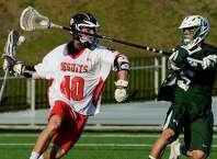 Delbarton's Grant Brewster knocks the ball out of the stick of Fairfield Prep's Patrick Lambert, during boys lacrosse action at Fairfield University in Fairfield, Conn., on Saturday Apr. 18, 2015