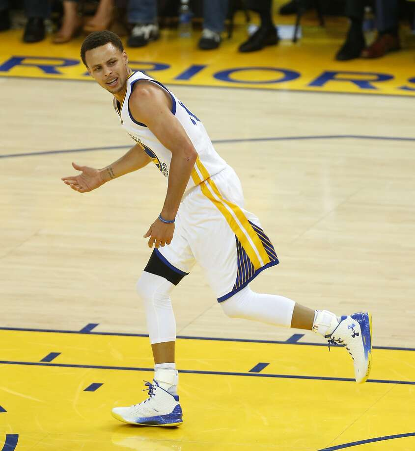 Golden State Warriors guard Stephen Curry reacts after a foul is not called on the New Orleans Pelicans during the first quarter of Game 1 of the NBA Western Conference 1st Round on Saturday, April 18, 2015 in Oakland, Calif. Photo: Beck Diefenbach, Special To The Chronicle