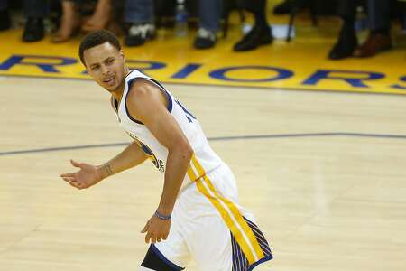 Golden State Warriors guard Stephen Curry reacts after a foul is not called on the New Orleans Pelicans during the first quarter of Game 1 of the NBA Western Conference 1st Round on Saturday, April 18, 2015 in Oakland, Calif.