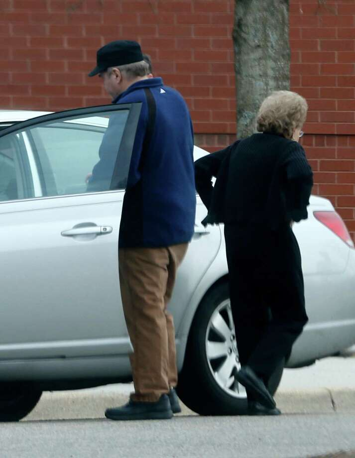 ADVANCE FOR SUNDAY, APRIL 19 AND THEREAFTER  - In this photo taken March 19, 2015, John Hinkley gets into his mother's car in front of a recreation center  in Williamsburg, Va. The last man to shoot an American president now spends most of the year in a house overlooking the 13th hole of a golf course in a gated community. He takes long walks along tree-lined paths, plays guitar and paints, grabs fast food at Wendy's. He drives around town in a silver Toyota Avalon, a car that wouldn't attract a second glance. Often, as if to avoid detection, he puts on a hat or visor before going out. These days, John Hinckley Jr. lives much of the year like any average Joe: shopping, eating out, watching movies at Regal Cinemas. (AP Photo/ Steve Helber) ORG XMIT: WX301 Photo: Steve Helber / AP