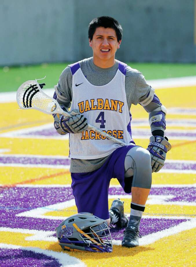 University at Albany lacrosse player Lyle Thompson poses before practice on Thursday, April 16, 2015, in Albany, N.Y. Thompson leads the nation in scoring for the third straight year with 6.5 points per game and became the all-time leading scorer in NCAA Division I history on Tuesday night with two goals and an assist in a 10-8 road win over Bryant. (AP Photo/Mike Groll)  ORG XMIT: NYMG107 Photo: Mike Groll / AP