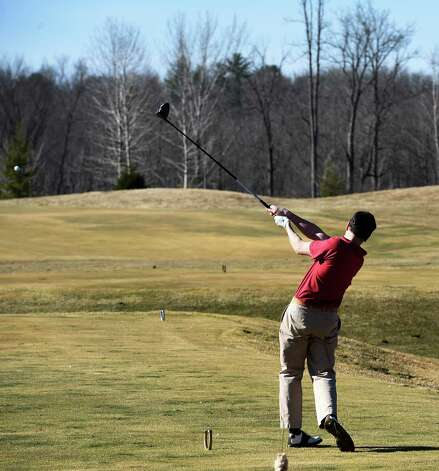 Greg Hollander of Schuylerville tees off on the Saratoga National Golf Course on opening day Wednesday April 15, 2015 in Saratoga Springs, N.Y.      (Skip Dickstein/Times Union) Photo: SKIP DICKSTEIN / 000314502A
