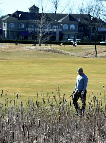 A golfer tries to find his ball on the course at Saratoga National Golf on opening day Wednesday April 15, 2015 in Saratoga Springs, N.Y.      (Skip Dickstein/Times Union) Photo: SKIP DICKSTEIN / 000314502A