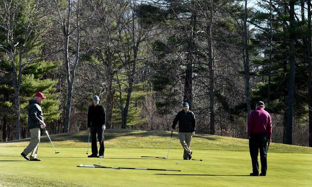 A foursome tries to determine who is away on the Saratoga National Golf Course on opening day Wednesday April 15, 2015 in Saratoga Springs, N.Y.      (Skip Dickstein/Times Union) Photo: SKIP DICKSTEIN / 000314502A