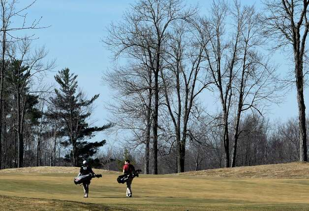Golfers John Costantino of Saratoga, left and Greg Hollander of Schuylerville are the first of the day to walk down the course at Saratoga National Golf on opening day Wednesday April 15, 2015 in Saratoga Springs, N.Y.      (Skip Dickstein/Times Union) Photo: SKIP DICKSTEIN / 000314502A