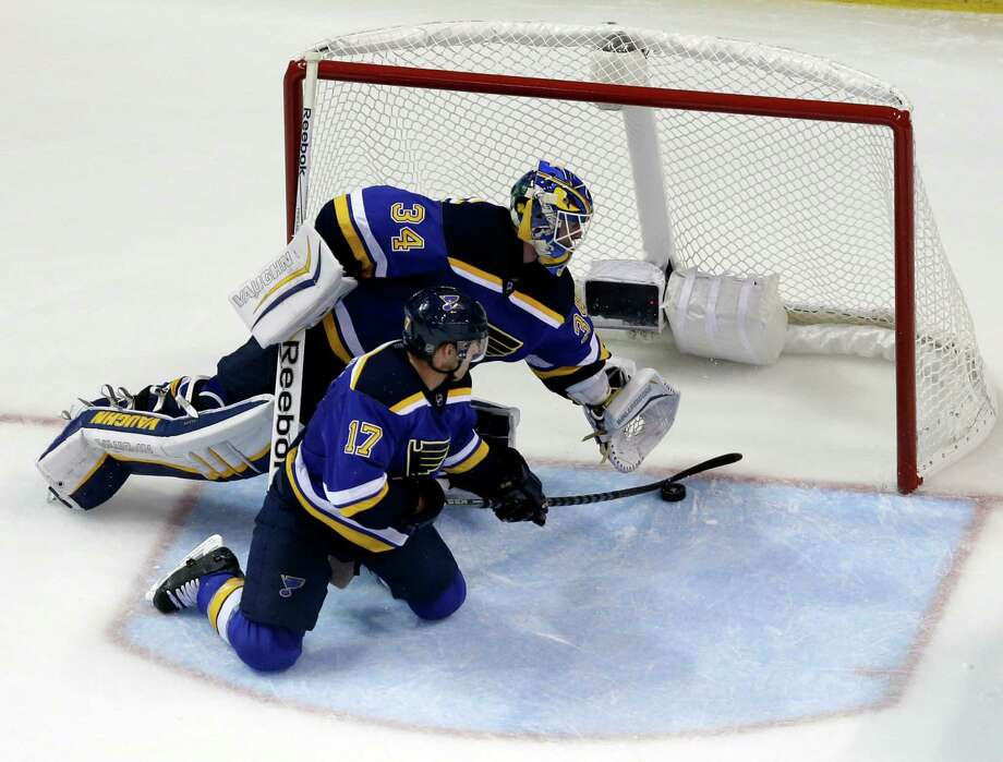 St. Louis' Jaden Schwartz keeps a puck from slipping past goalie Jake Allen and into the net. Photo: Jeff Roberson / Associated Press / AP