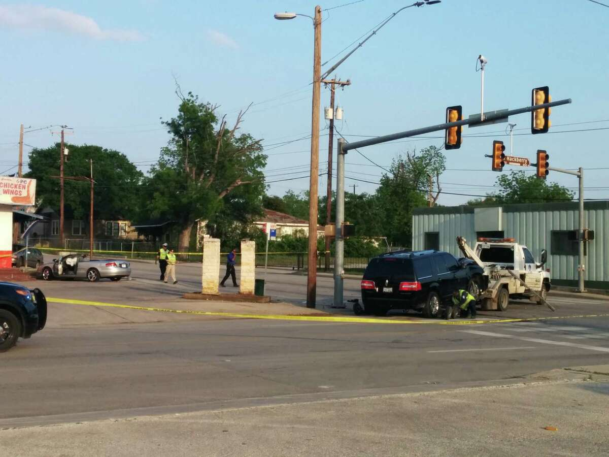 Police investigate the scene of a collision involving Mayor Ivy Taylor's SUV Saturday evening at the intersection of East Houston Street and North Hackberry.