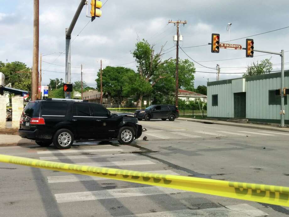 Police investigate the scene of a collision involving Mayor Ivy Taylor's SUV Saturday evening at the intersection of East Houston Street and North Hackberry. Photo: By Jacob Beltran, San Antonio Express-News