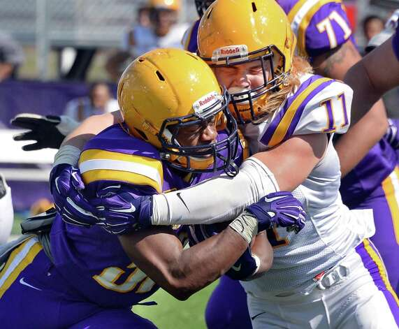 Running back #39 Elliot Croskey, left, is stopped by #11 Michael Nicastro during UAlbany football's Spring Game Saturday April 18, 2015 in Albany, NY.  (John Carl D'Annibale / Times Union) Photo: John Carl D'Annibale / 00031485A