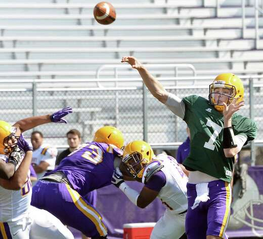 Quarterback #7 Will Brunson, right, gets off a pass during UAlbany football's Spring Game Saturday April 18, 2015 in Albany, NY.  (John Carl D'Annibale / Times Union) Photo: John Carl D'Annibale / 00031485A